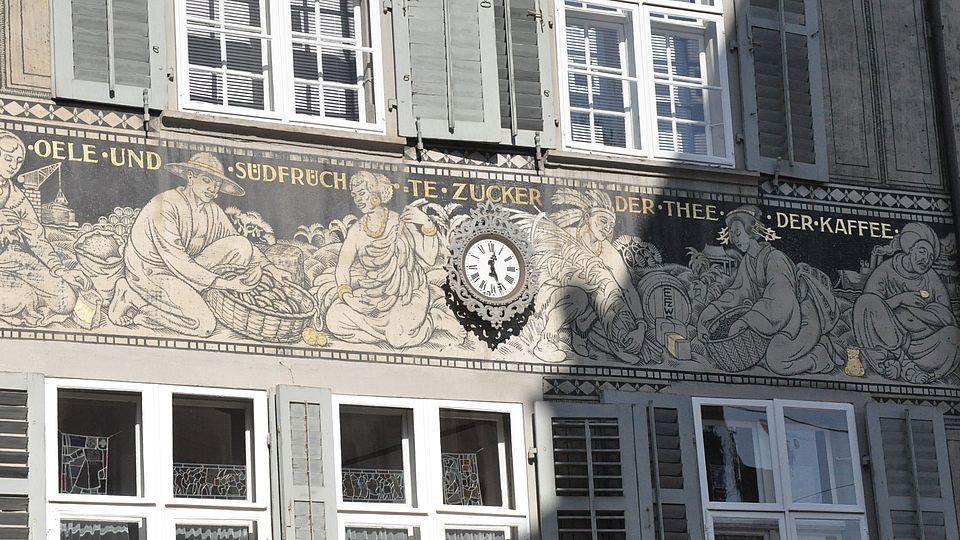 Mural depicting colonial trade goods on a house on Spalenberg