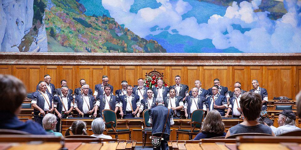 a choir performing at swiss parliament